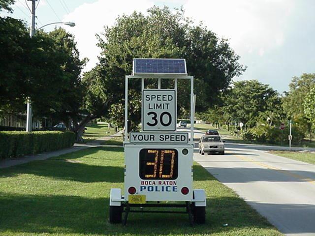 "Mobile speed detector, with a ""Speed Limit 30"" sign and screen which displays passing vehicle"