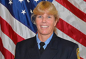 Sherry Griffith, 2018 Firefighter of the Year, posing in front of American Flag